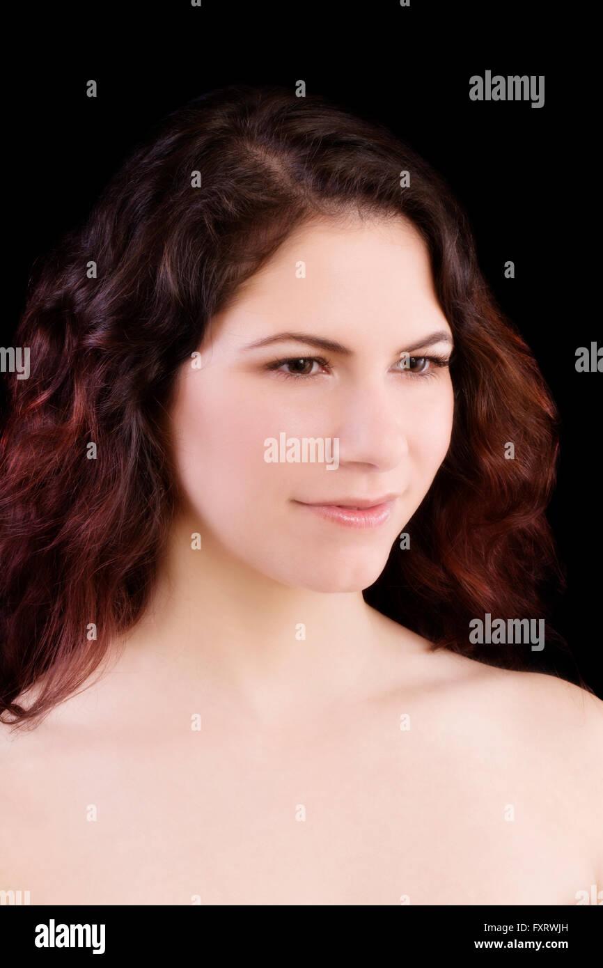 Bare Shoulder Portrait Caucasian Woman With Dark Hair - Stock Image