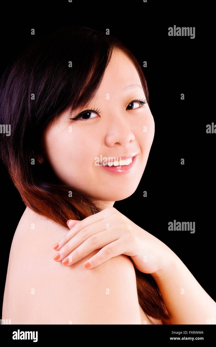 Bare Shoulder Portrait Smiling Asian American Woman - Stock Image