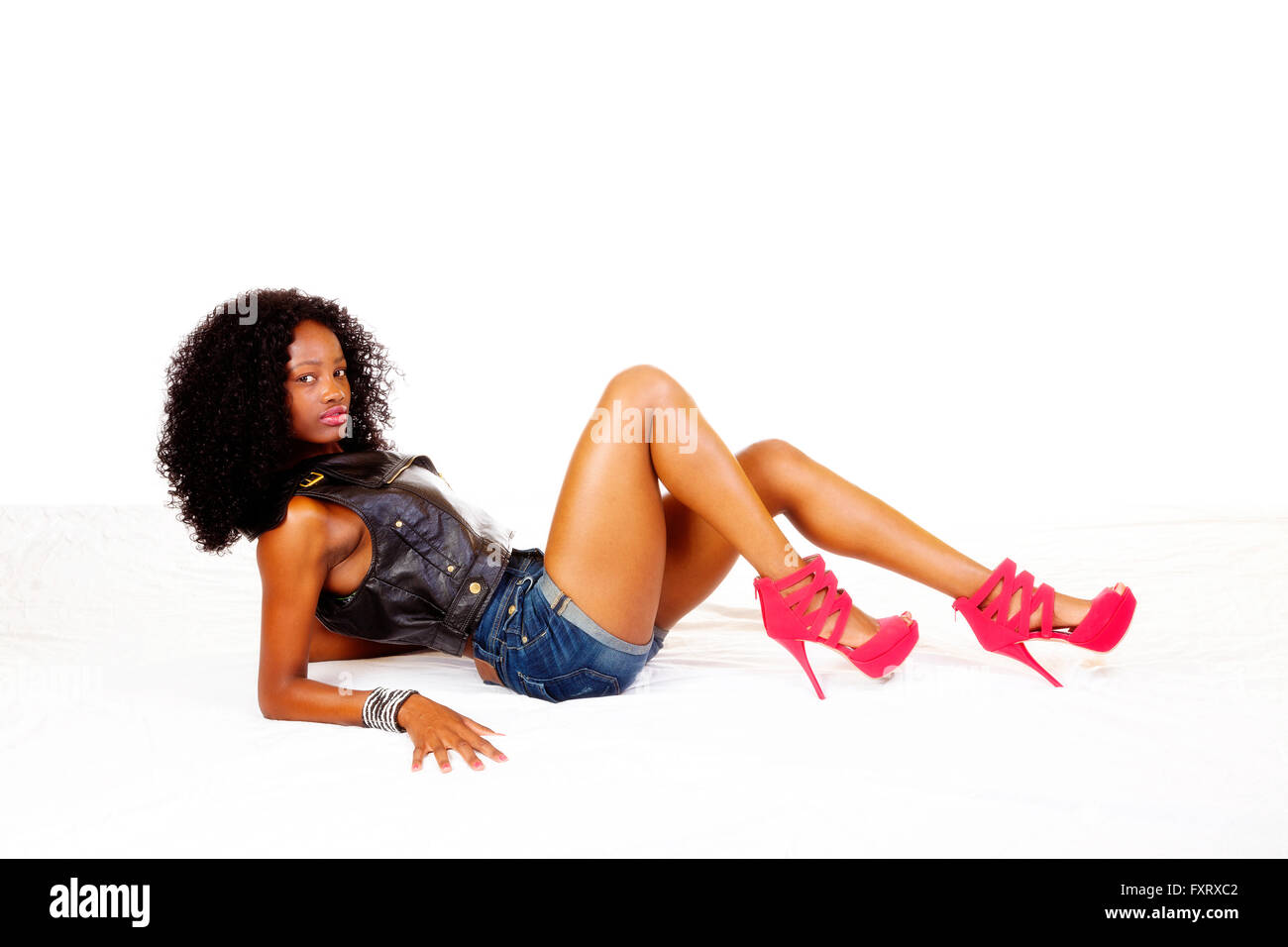 Attractive Black Teen Girl Reclining Shorts Vest - Stock Image