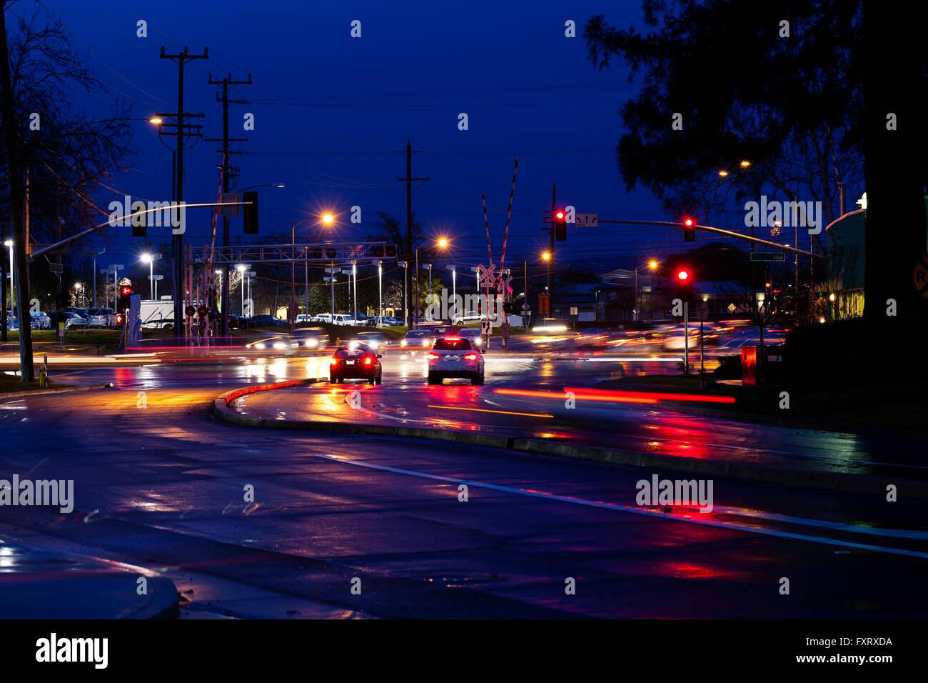 Night Street Automobile Traffic Rail Road Crossing - Stock Image