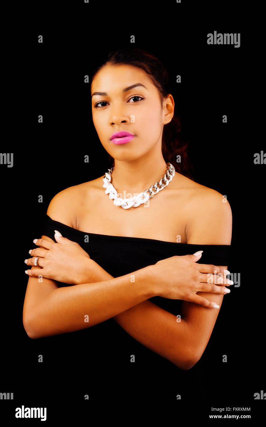 Bare Shoulders Arms Crossed Attractive Latina Woman - Stock Image