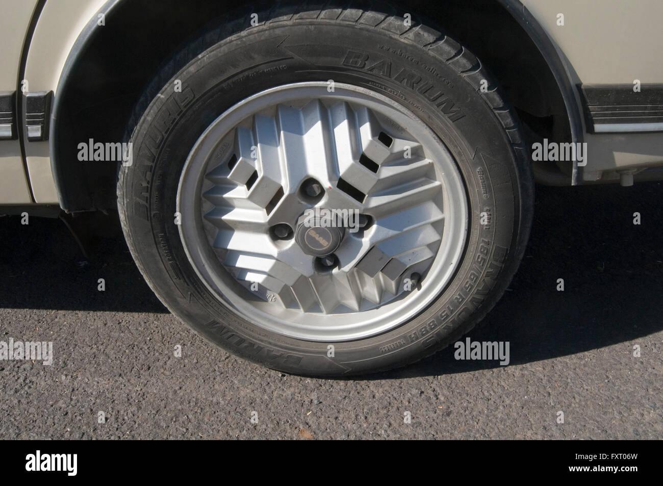 Saab 900 turbo car cars strange unusual wheels wheel deign called Aztec aztecs - Stock Image
