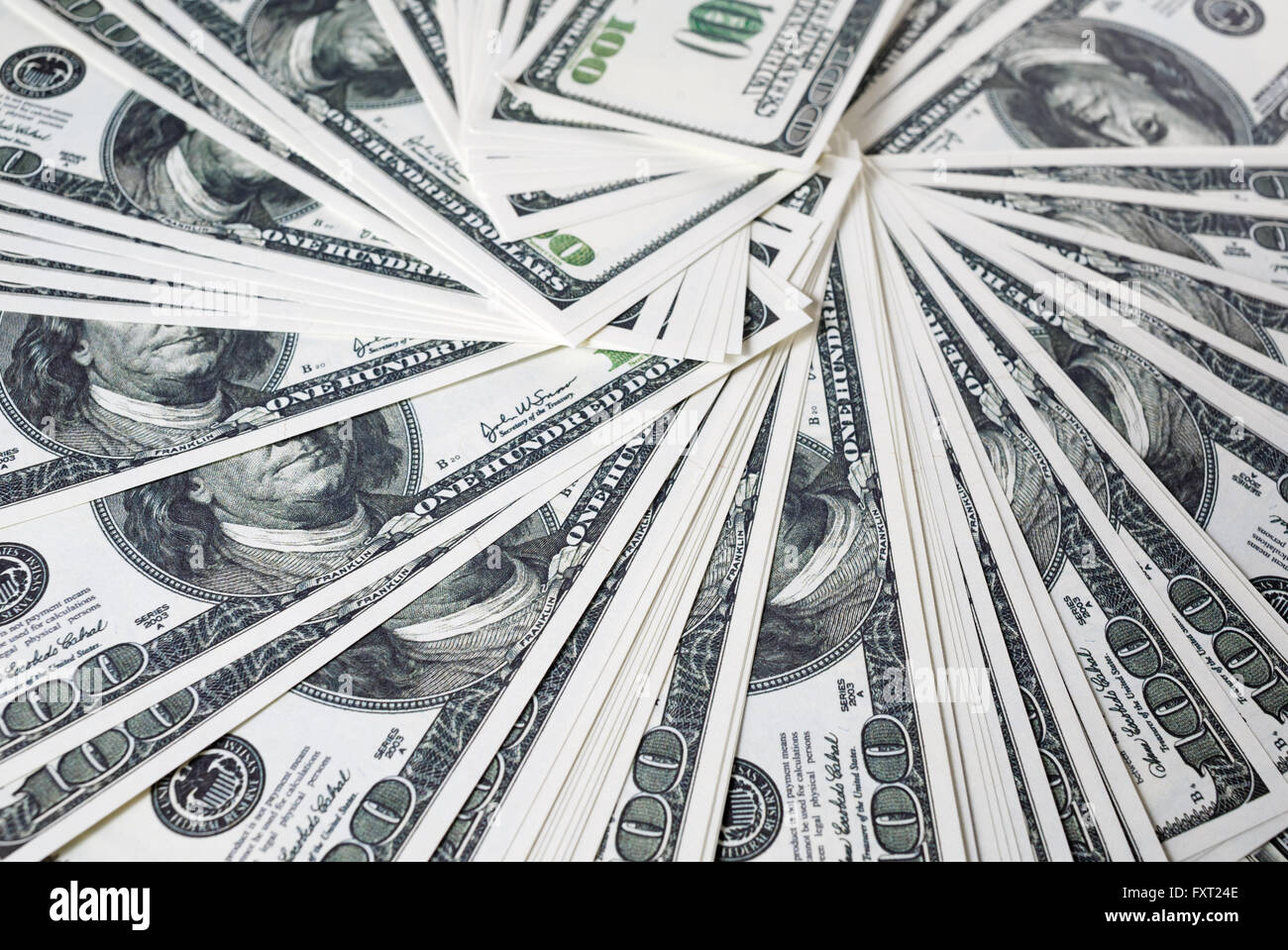 Close-up of a lot of one hundred dollar bills. Much money. A lot of money. Counterfeit money. Selective focus. - Stock Image