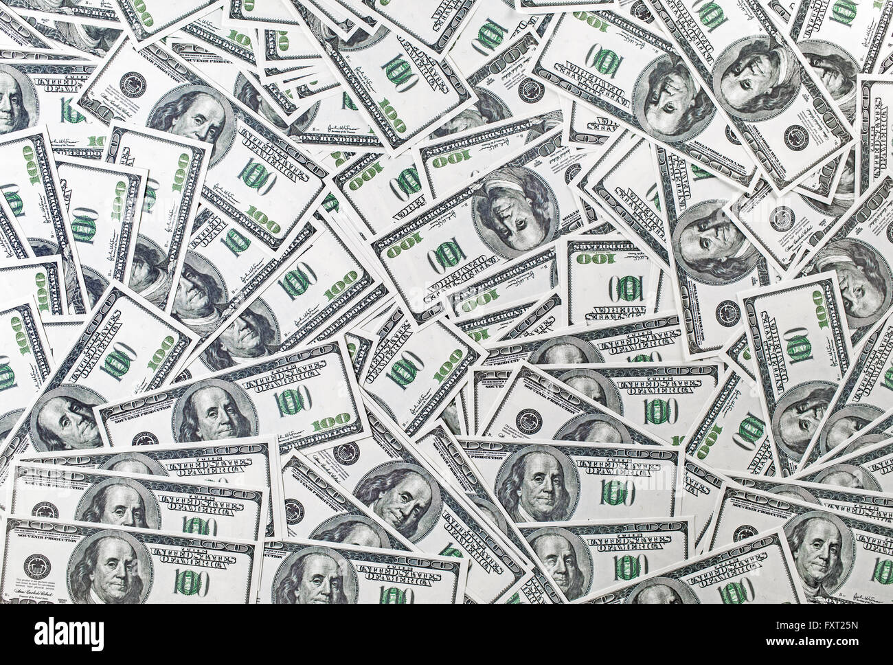 Background from a variety of one hundred dollar bills. Many dollars. Money background. Fake money. - Stock Image