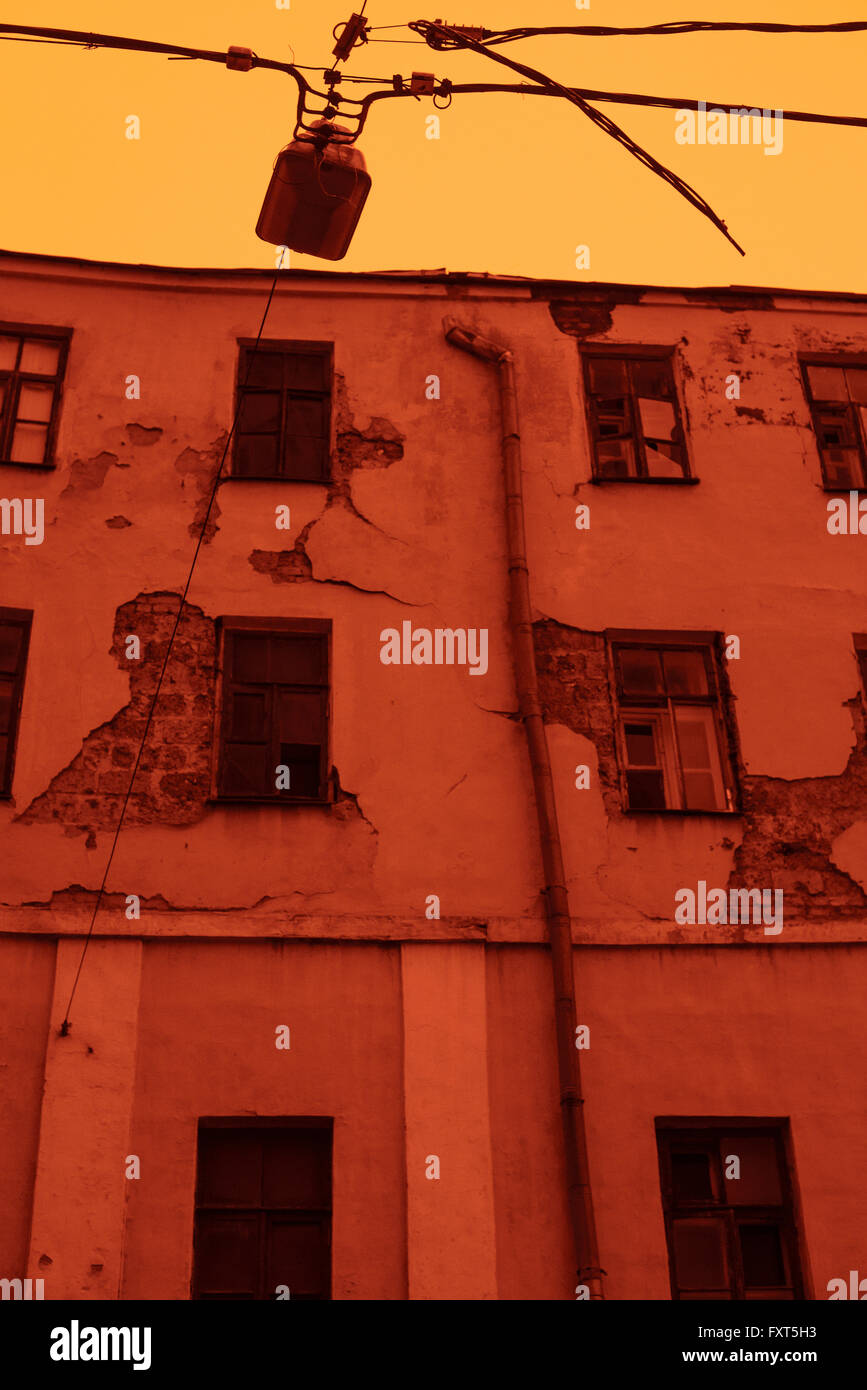 Old abandoned house in Moscow city center (Savinskiy pass). Image is captured with red filter to minimize colours - Stock Image