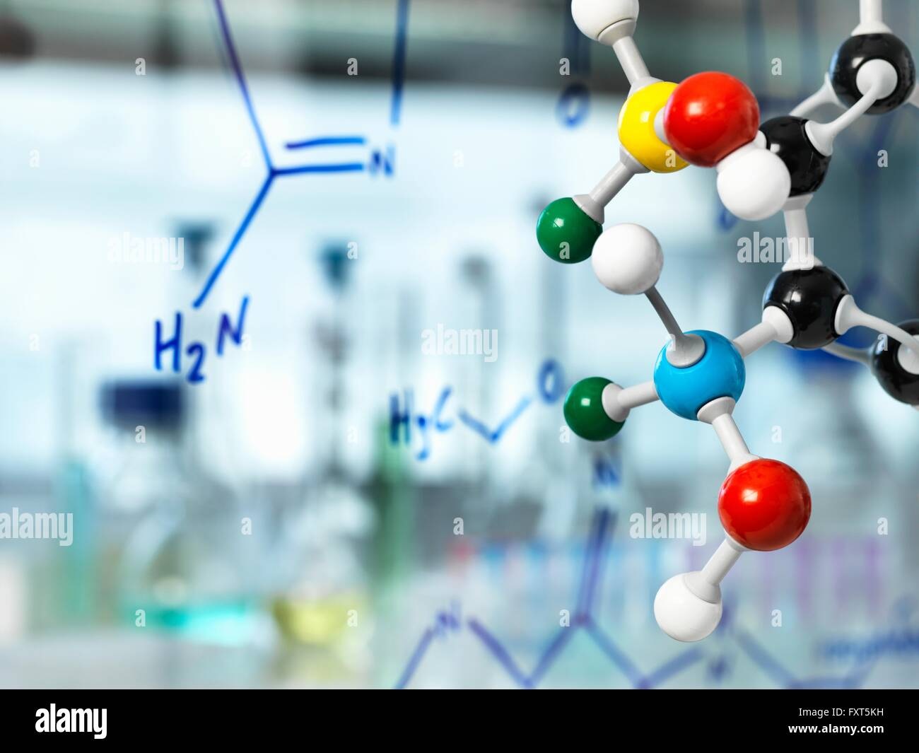 Ball and stick molecular model with chemical formula written on glass - Stock Image