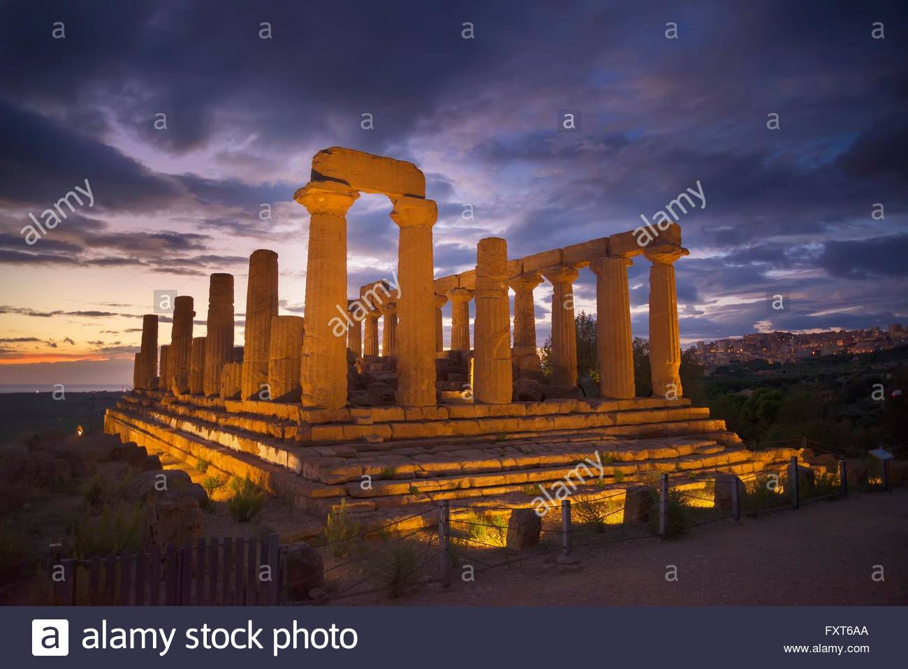 Floodlit Temple of Juno at dusk, Valley of the Temples, Agrigento, Sicily, Italy - Stock Image