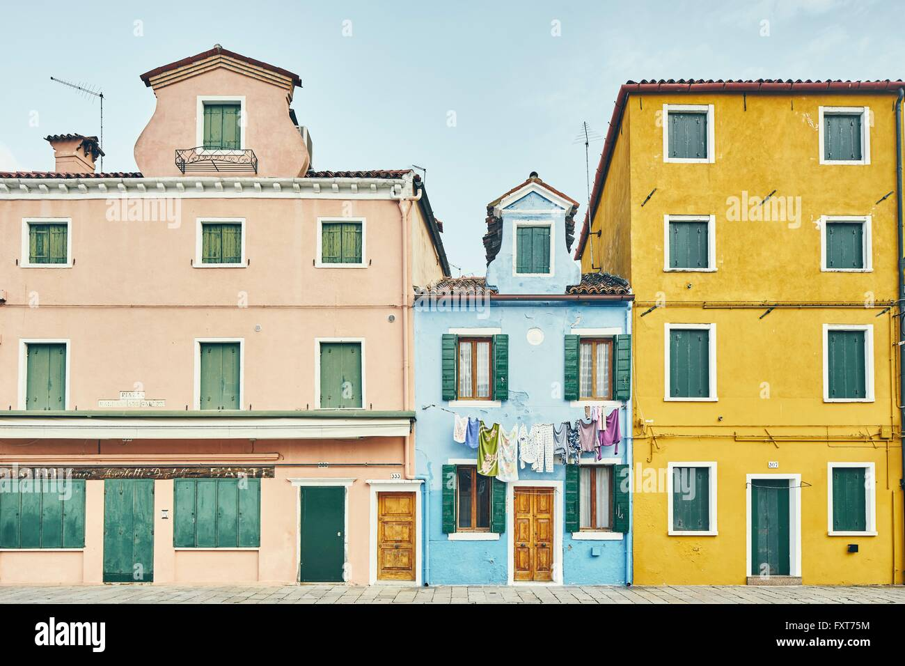 Facade of traditional multi colored houses, Burano, Venice, Italy - Stock Image