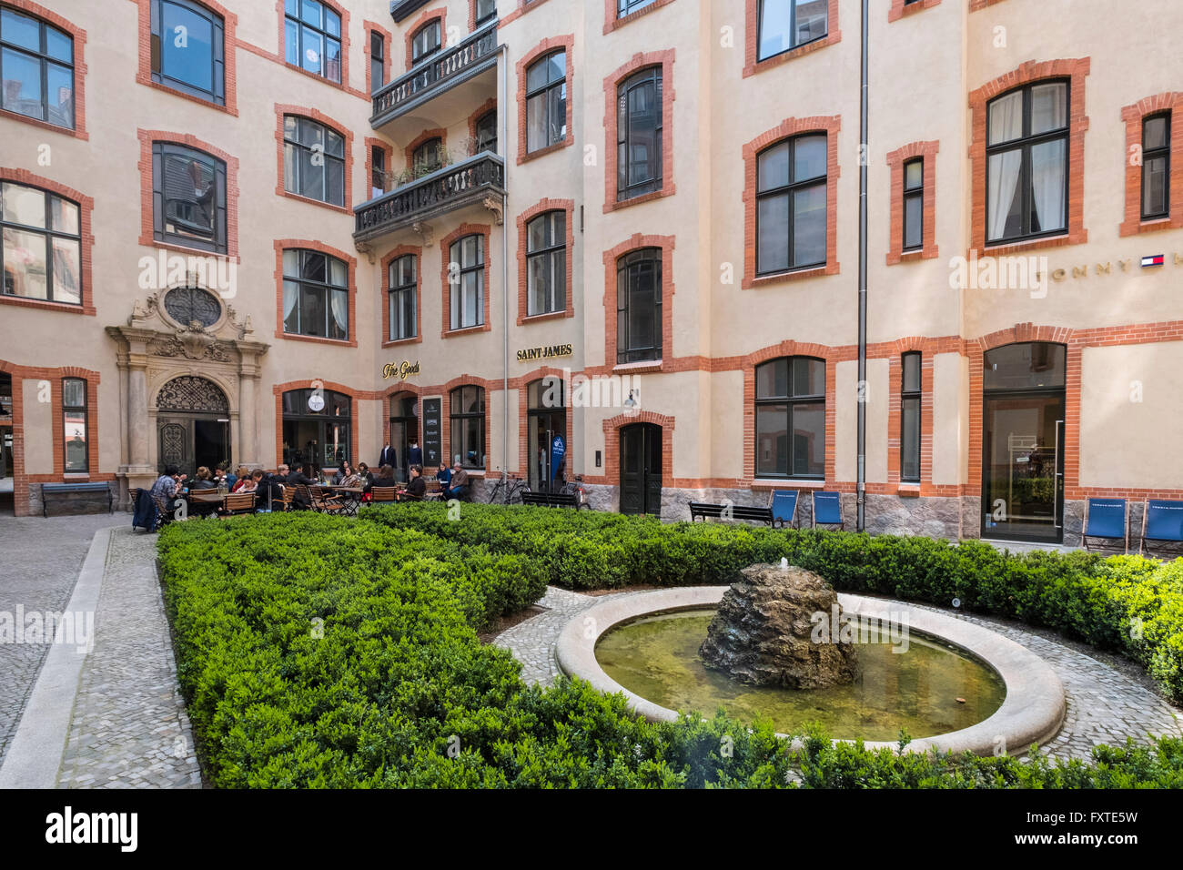 Blue Yard courtyard containing cafes and fashion boutiques and shops in Mitte Berlin Germany - Stock Image