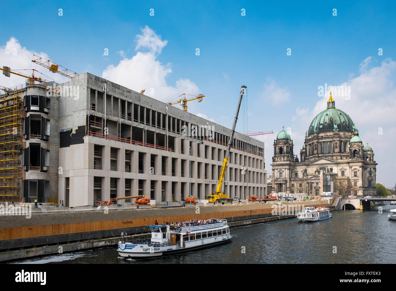 New Humboldt Forum under construction beside Spree River with Berlin Cathedral to rear in Berlin Germany - Stock Image