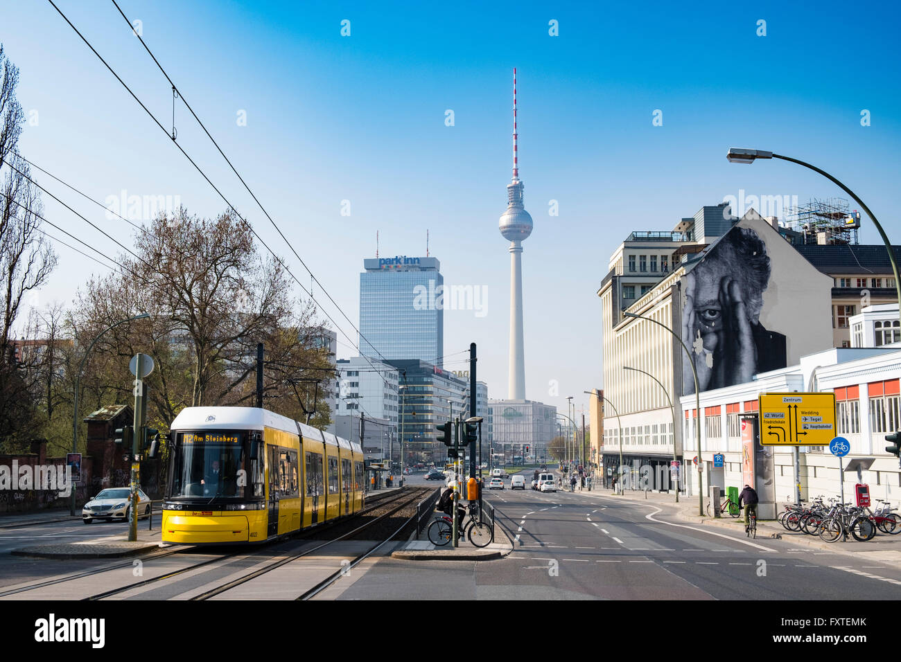 'JR' mural on building wall and Television Tower in Berlin Germany - Stock Image