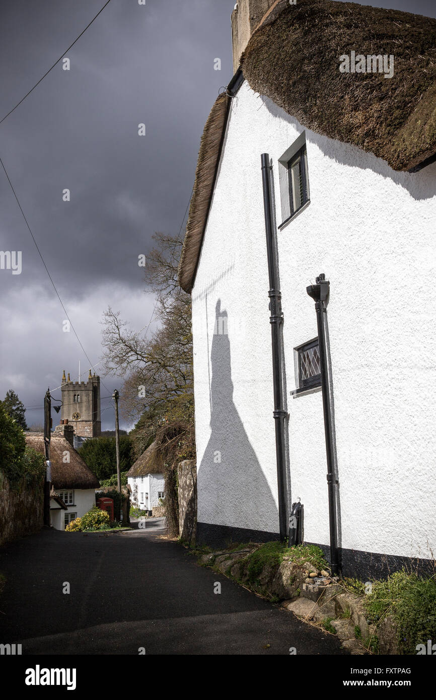 Thatched cottages and church at North Bovey,North Bovey is a village and civil parish situated on the south-eastern - Stock Image