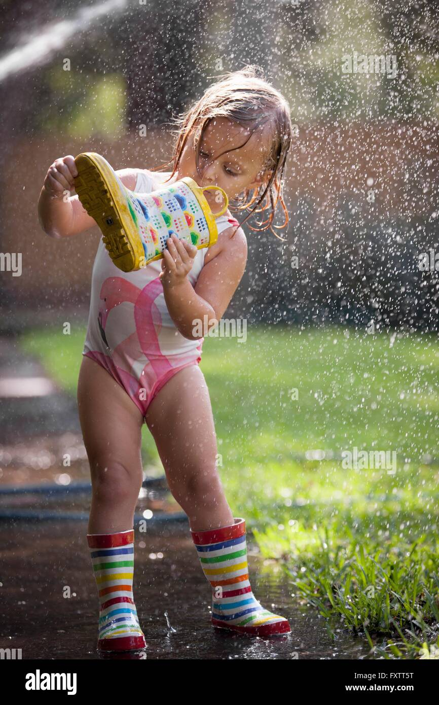 Child looking into welly Stock Photo