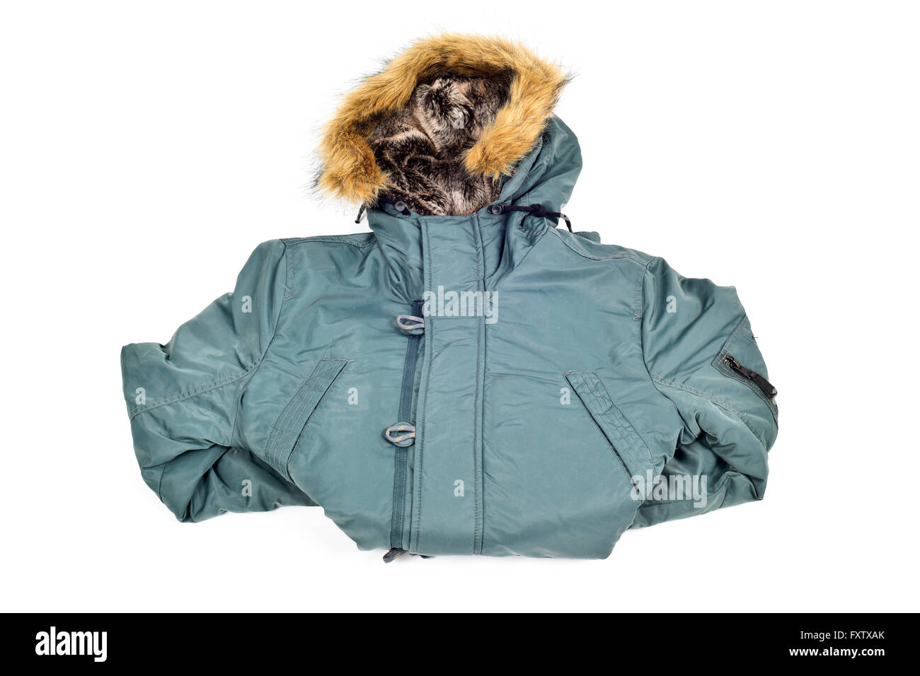a warmer green parka with a fur lined hood on a white background - Stock Image