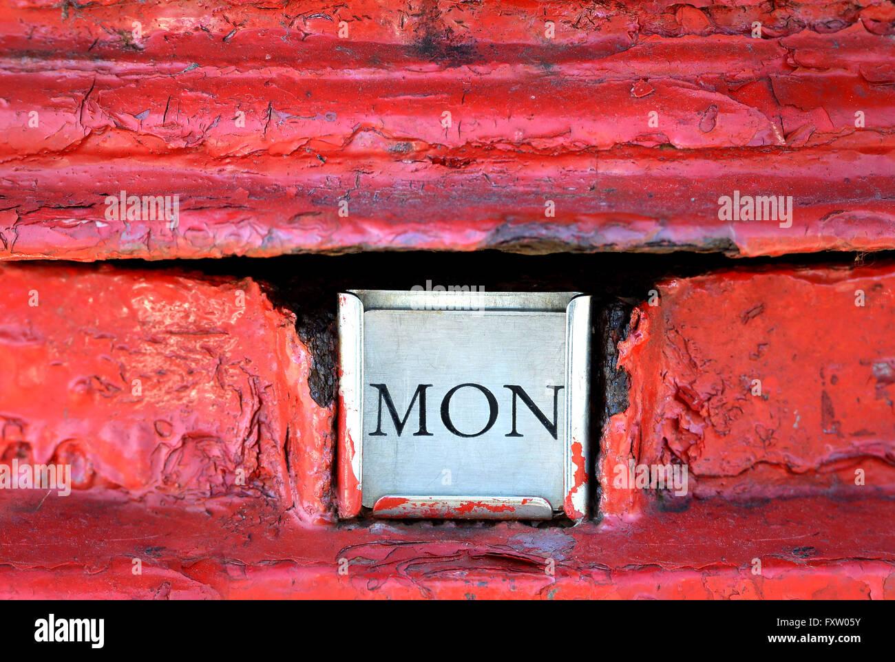 Rusty red post box, Monday - Stock Image