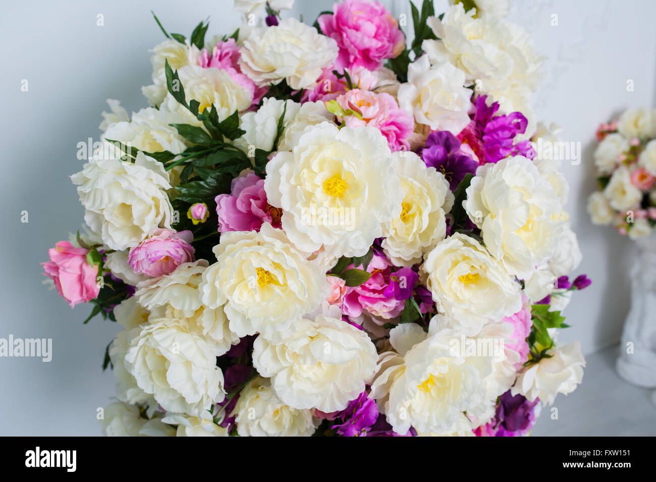 Beautiful And Big Bouquet Of Flowers On The Wall Background Stock
