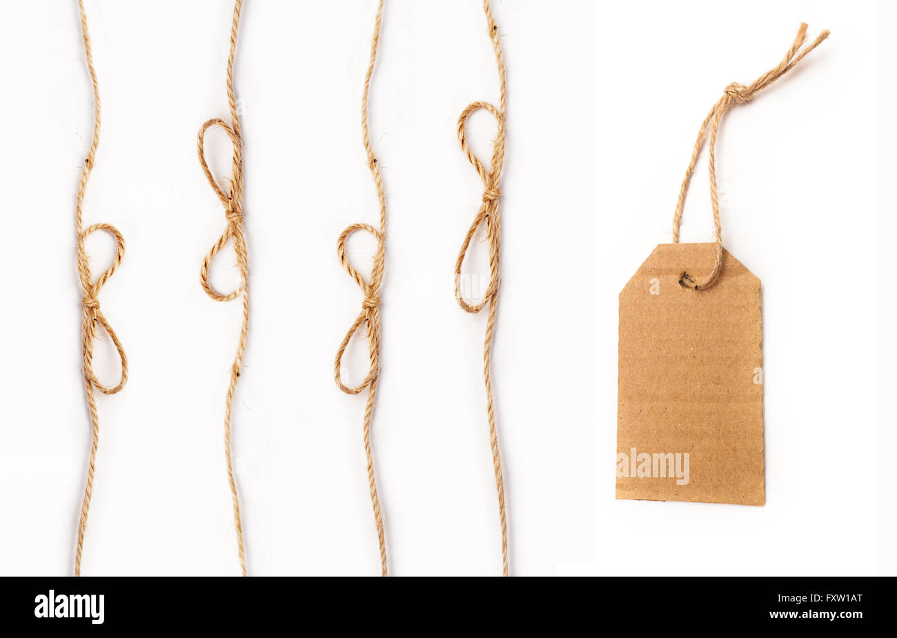 rope with a bow and tag on white background - Stock Image