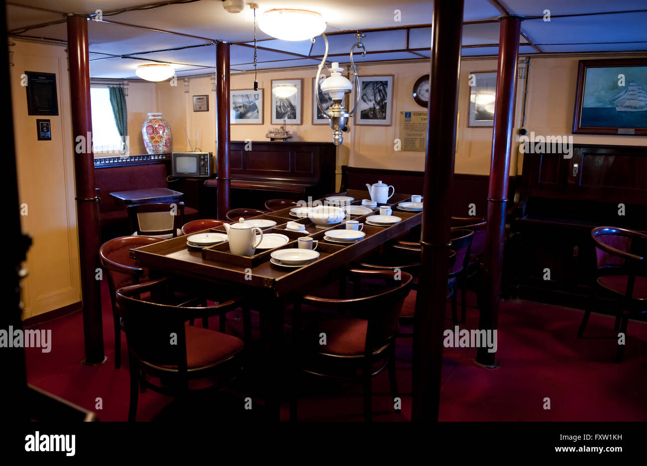 Wardroom mess cabin in Dar Pomorza ship, room interior at the sailing vessel in Gdynia, Poland, Europe, legendary - Stock Image