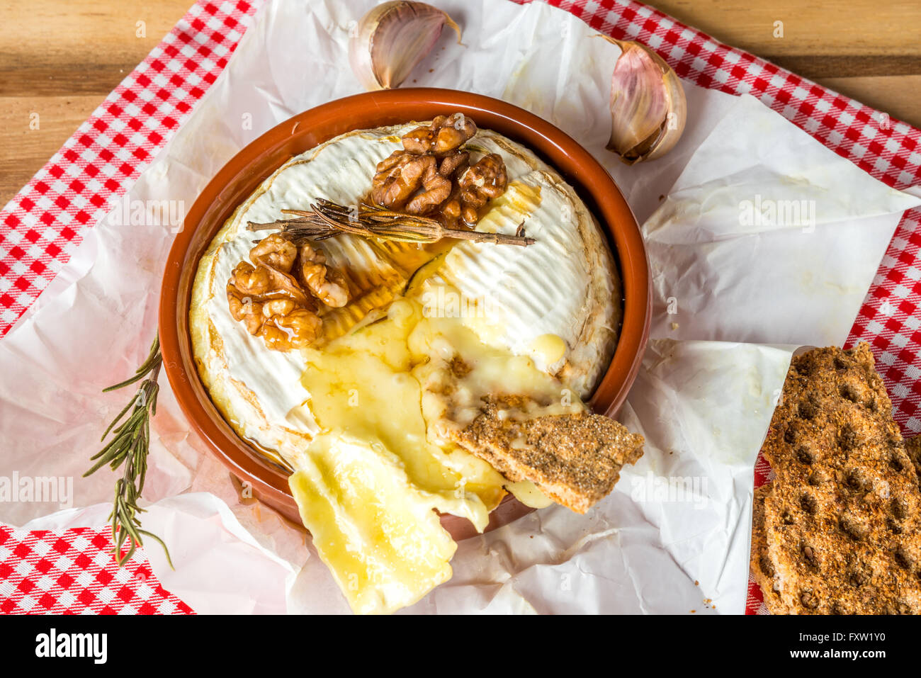 Baked Camembert cheese with Honey, Garlic and Rosemary - Stock Image