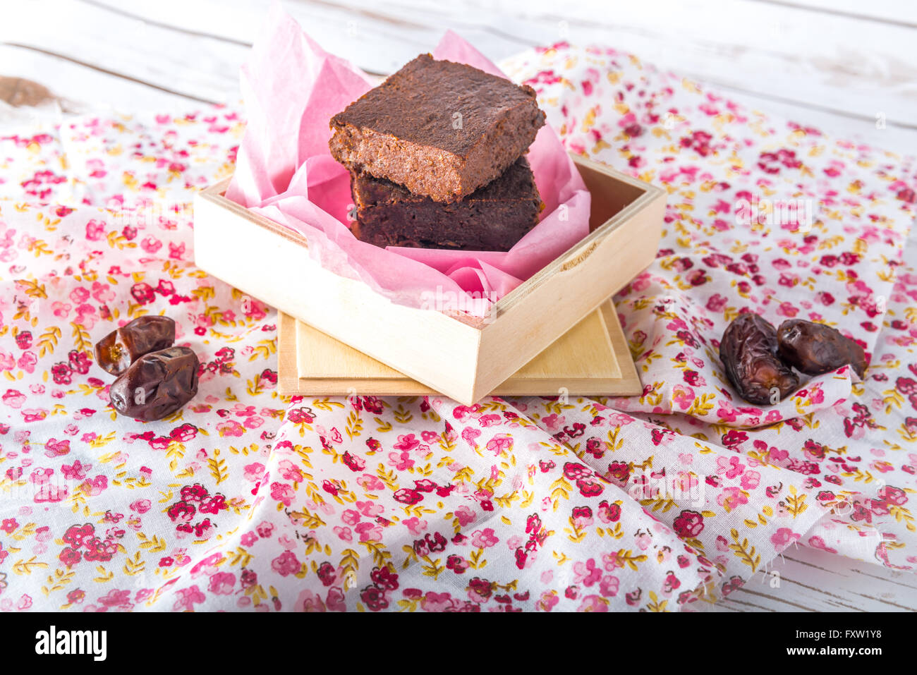 Healthy gluten free Paleo style brownies made with sweet potato, dates and almond flour in a wooden box - Stock Image