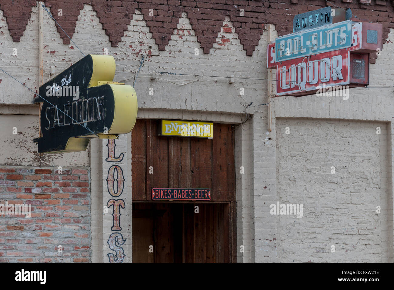 Signs on the front of a defunct saloon and casino on Highway 50 in Austin, Nevada. - Stock Image