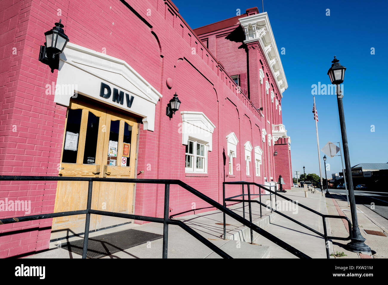 Historic red brick building in downtown Eureka, Nevada, United States, that houses the DMV (Department of Motor - Stock Image