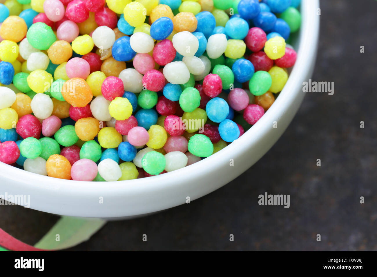 multi-colored fruit jelly beans sweet candy topping - Stock Image