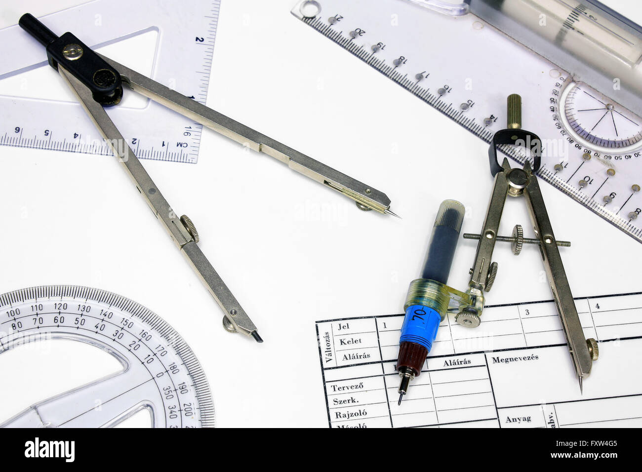Technical tracing paper and rulers, calipers with ink - Stock Image