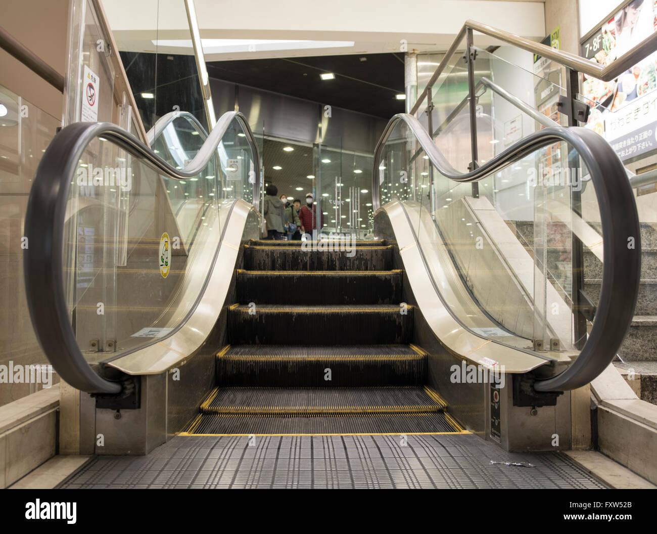 Petite Escalator 'Petitecalator' in between Kawasaki More's and the underground walkway. World's - Stock Image