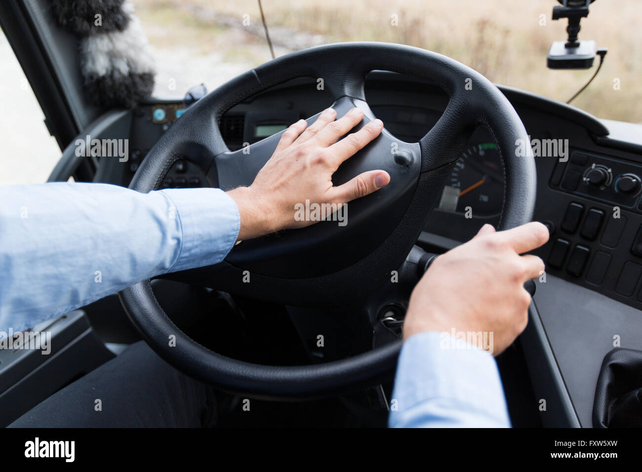 close up of driver driving passenger bus - Stock Image