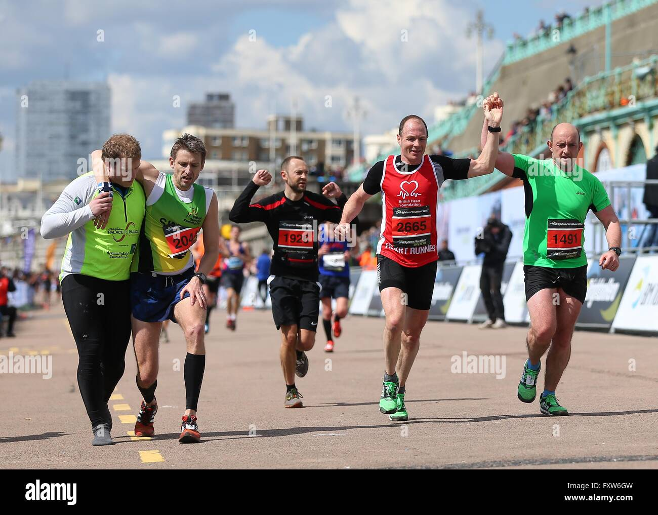 Runner Across Finish Line Wiring Diagrams 5v Load Cell Amp Using Ina125p Autodesk Circuits A Is Helped The During 2016 Brighton Rh Alamy Com Olympic Dives