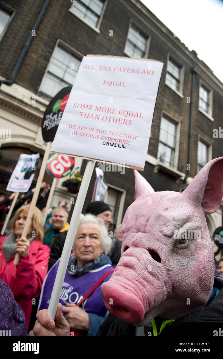 March organized by the People's Assembly, demonstrators protest  against austerity.  A woman holds a placard - Stock Image