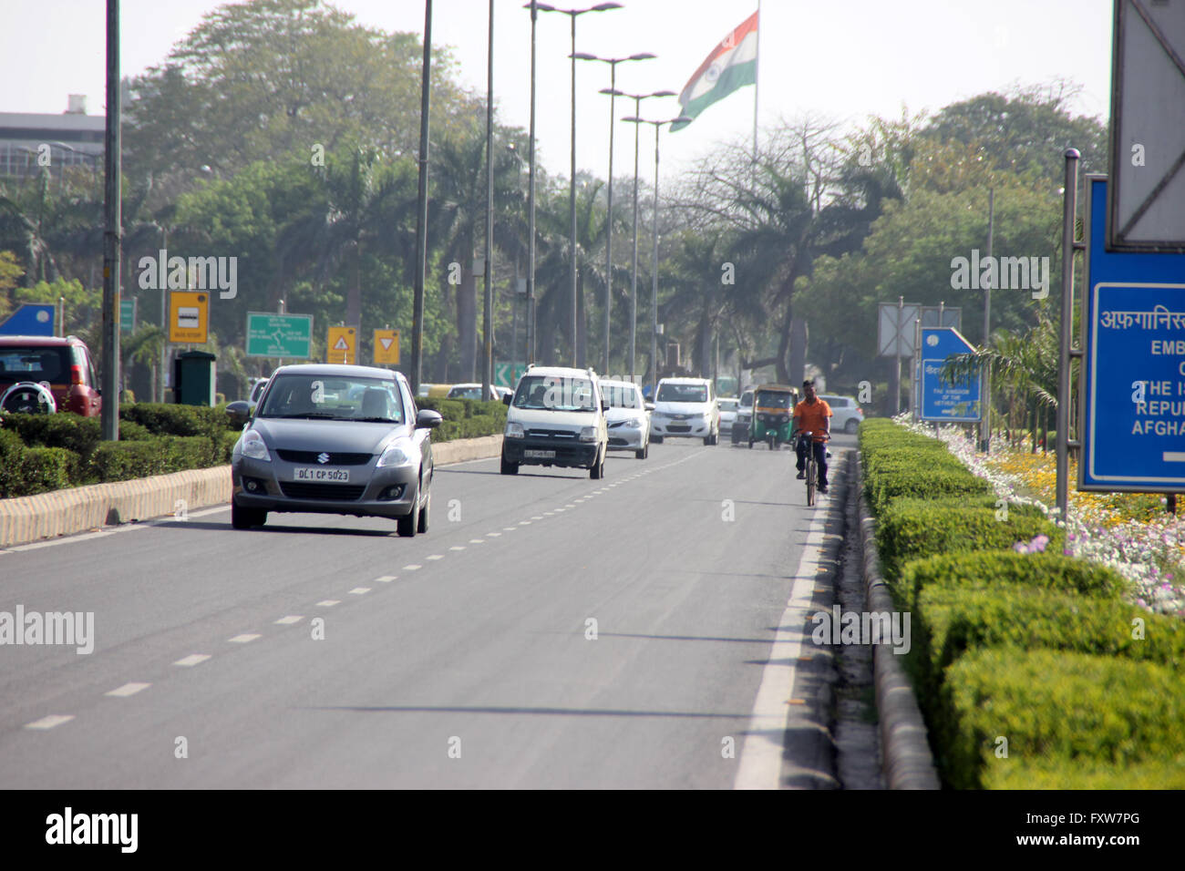 Shanti Path, New Delhi, with beautiful hedges on both sides, well maintained flower beds and lawns, embassies on Stock Photo