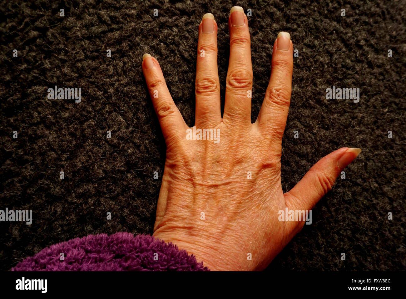 Wrinkled hand. - Stock Image