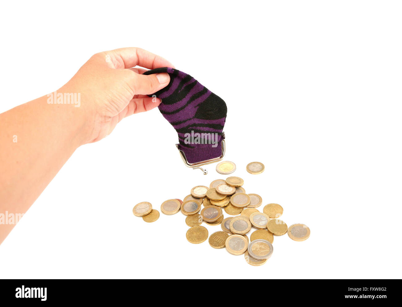 A woman empties her sock which is filled with euro coins - Stock Image