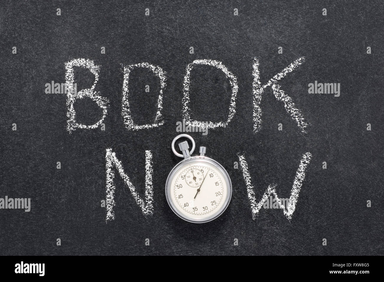 book now watch phrase handwritten on chalkboard with vintage precise stopwatch used instead of O - Stock Image