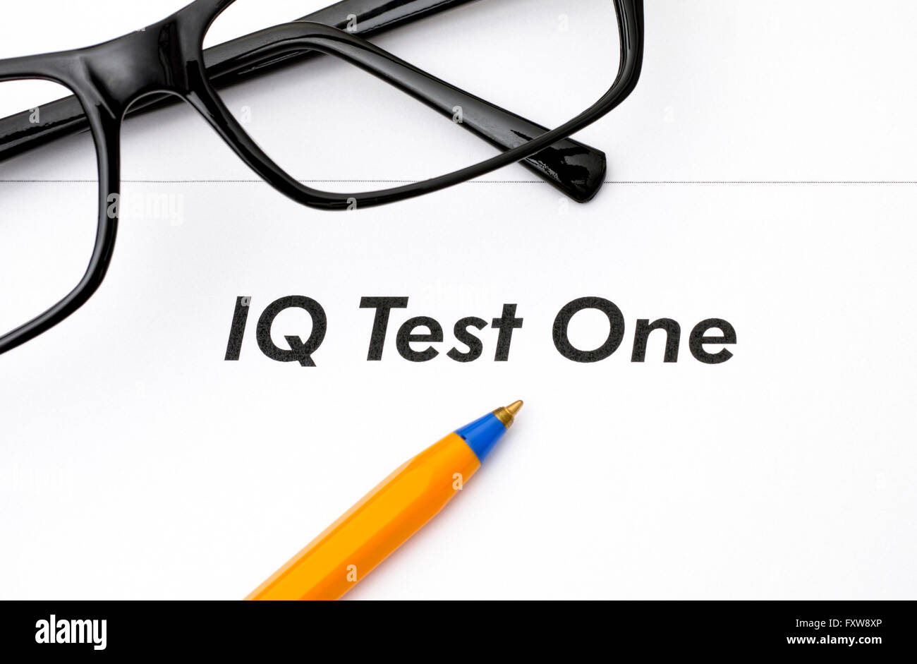IQ test One with glasses and ballpoint pen - Stock Image