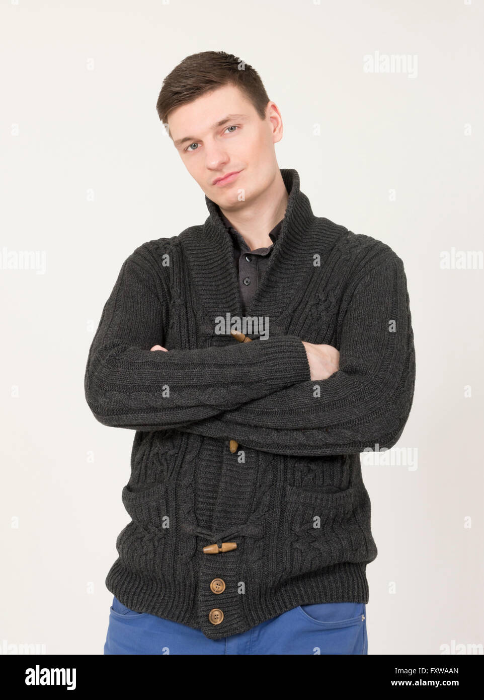 Handsome young man with microphone - Stock Image