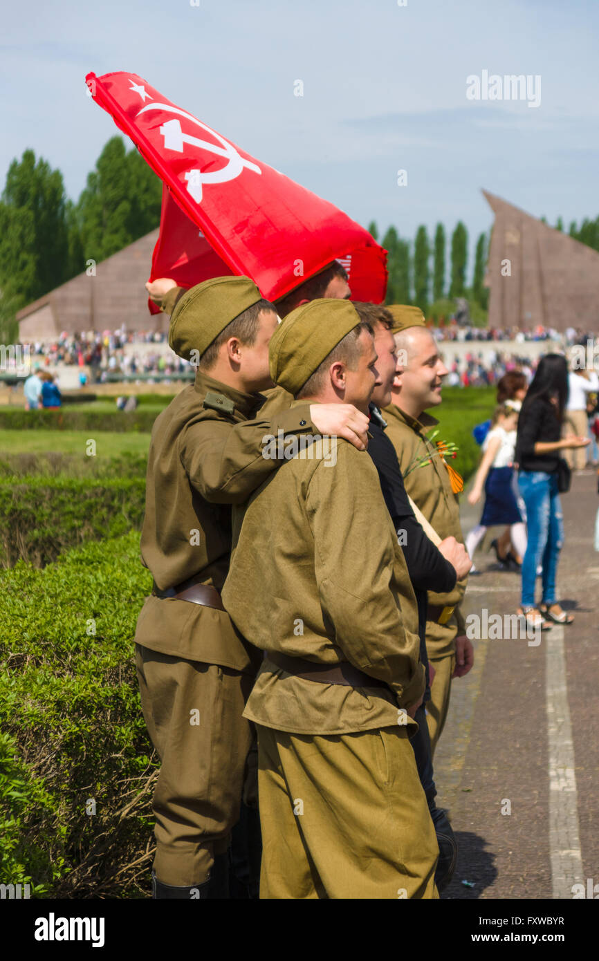 Victory Day in Treptower Park. Soldiers in the uniform of the Red Army during the war, and with the flag of the Stock Photo