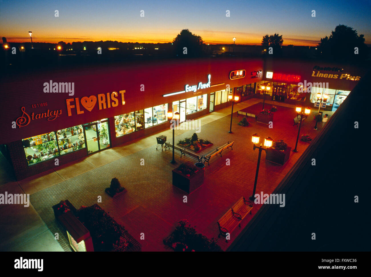 Aerial view of large strip shopping mall at sunset; central New Jersey; USA - Stock Image