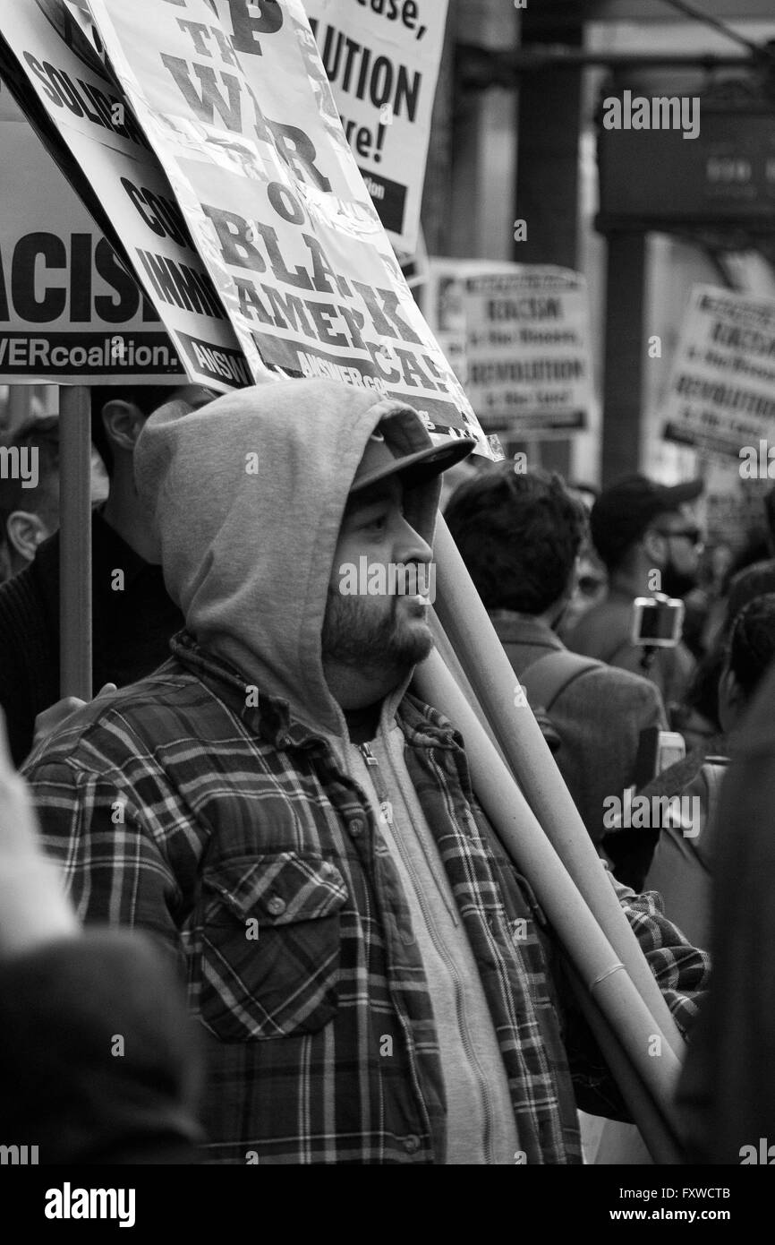 Picket Line- Not a strike- this anti-Trump demonstrator pauses with his signs to listen to a rally speaker - Stock Image