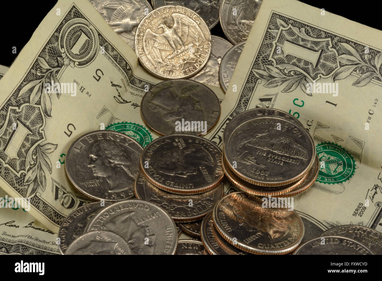 Savings, thrift, poverty, taxes, riches, couch cushion money, dollars, dimes, nickels and quarters - Stock Image