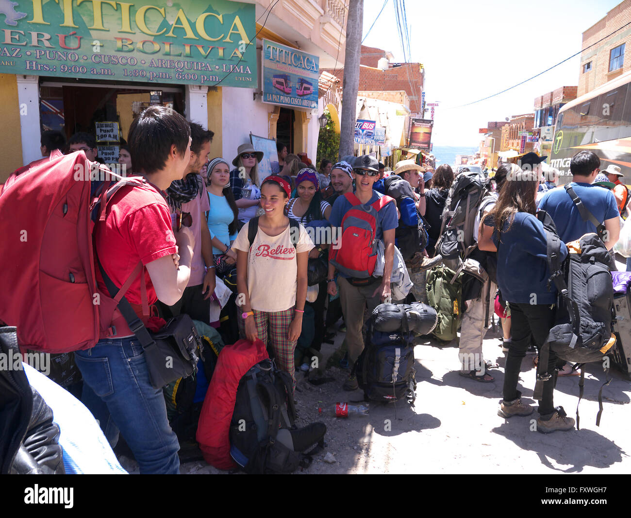 Backpackers in the streets of Copacabana Bolivia South America - Stock Image