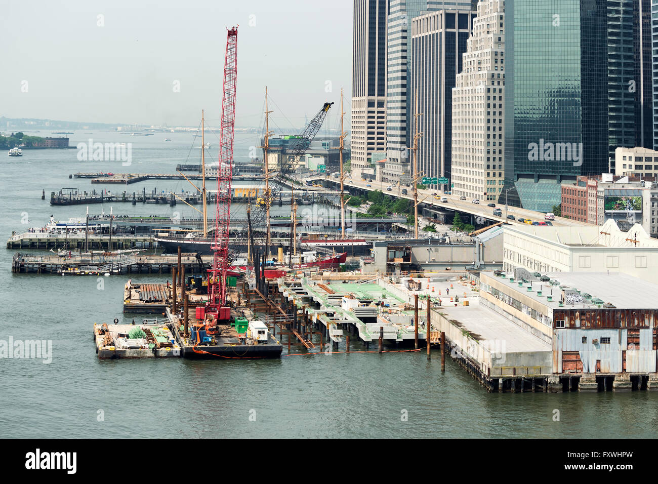NEW YORK CITY, USA - JUNE 12, 2015: Construction site and pier on Hudson river, along the highway in New York City. Stock Photo