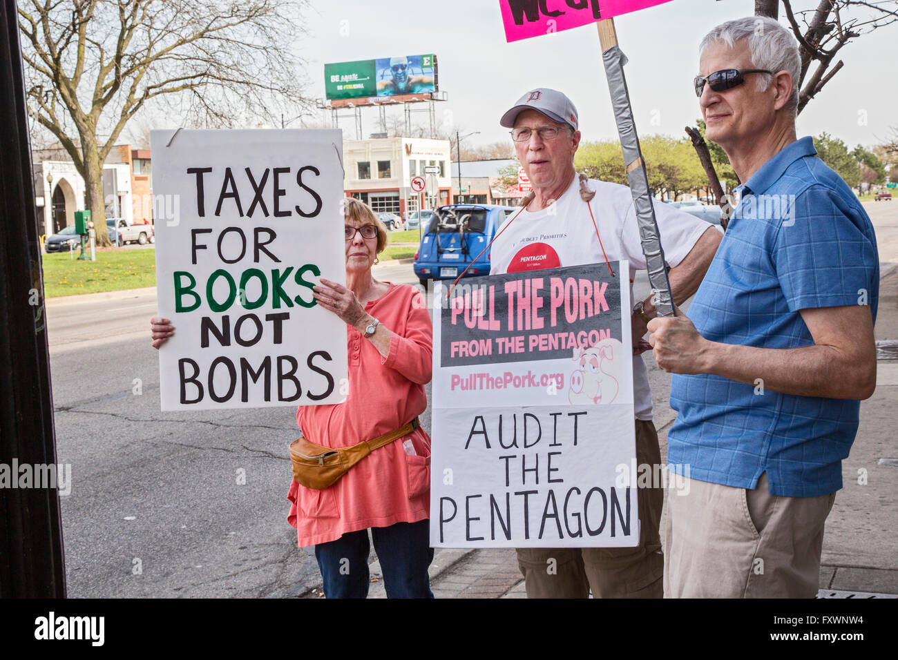 Ferndale, Michigan, USA. 18th April 2016. Protesters gather at the income tax filing deadline to call for peaceful - Stock Image