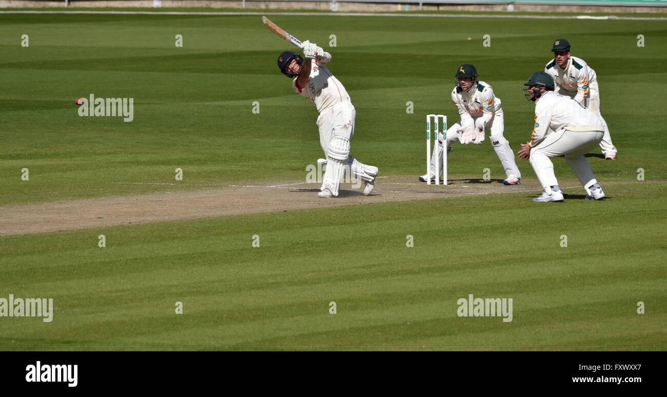 Manchester  UK  19th April 2016 Simon Kerrigan (Lancashire) drives to the boundary on the morning of Day 3 of the - Stock Image