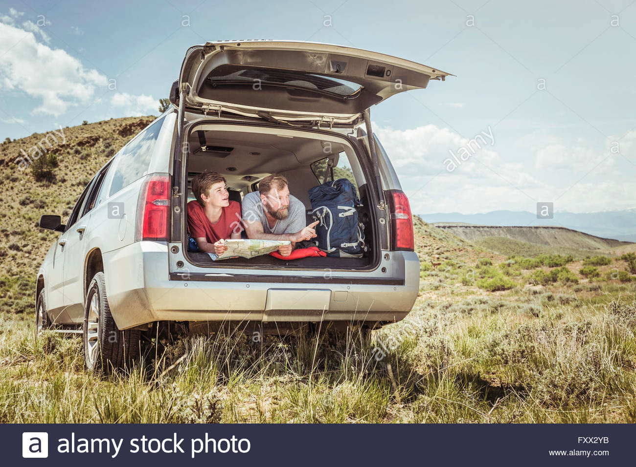 Bridger Montana Map.Mature Man And Teenage Son Pointing Whilst Reading Map From Off Road