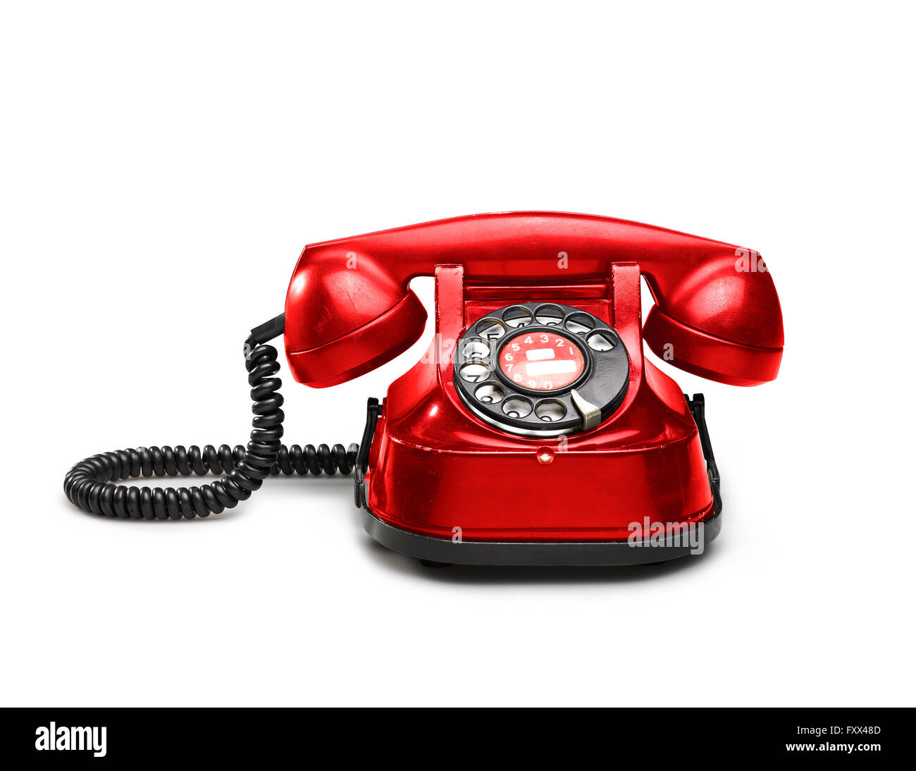 An old red telephon with rotary dial - clipping path - Stock Image