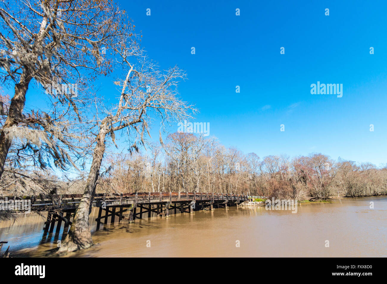 Lorrain Bridge in Hayes, LA, an old historic wooden bridge with the quintessential Cajun backdrop. Built in the - Stock Image