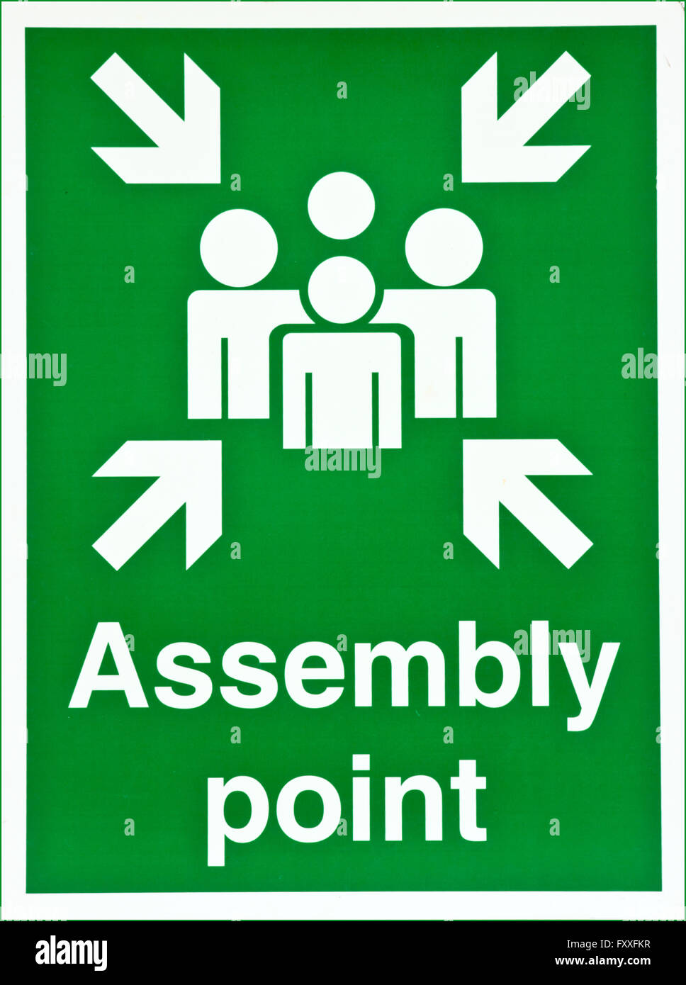 Green fire assembly point sign - Stock Image